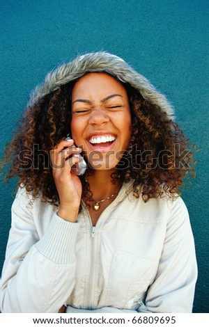 Young woman talking on mobile phone - stock photo