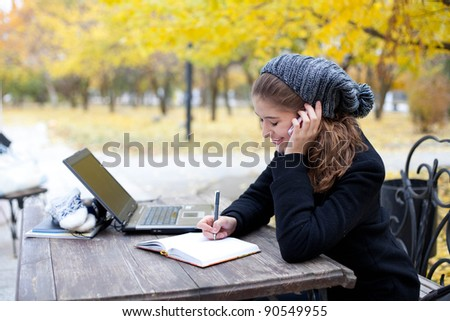 young woman talking on phone - stock photo