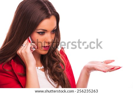 Young woman talking on the phone, studio shot - stock photo
