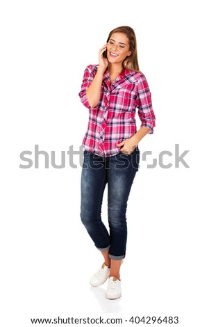 Young woman talking through a mobile phone - stock photo