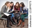 Young woman teacher teach God's Words to a women team - stock photo