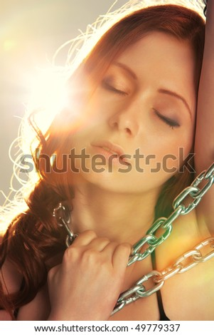 Young woman tender portrait. Bright flash on background. - stock photo