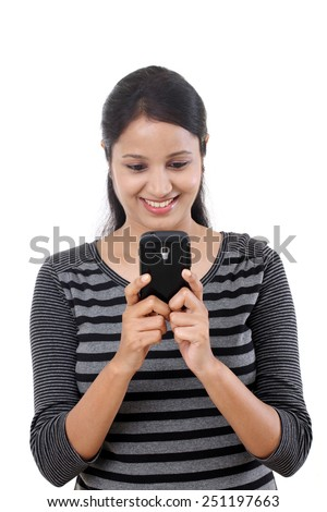 Young woman texting on her mobile phone - stock photo