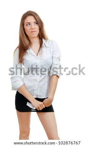 young woman thinking after checking over the receipt in her hands and spending too much - stock photo