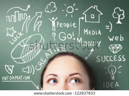 Young woman thinking and dreaming about her future - stock photo