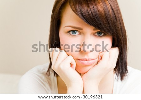 Young woman thinking and worrying - stock photo