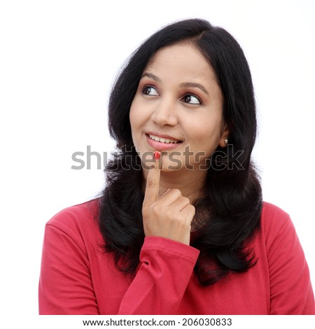Young woman thinking gesture against white background - stock photo