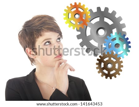 Young woman thinking with gears isolated on white background - stock photo