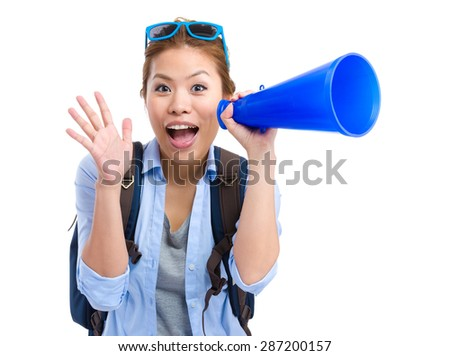 Young woman thrilled to use the megaphone for yelling - stock photo