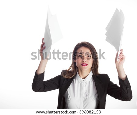 Young woman throwing away papers - stock photo