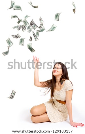 Young woman throwing 100 dollar bills up isolated on white - stock photo