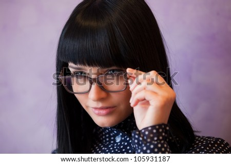 young woman touch her glasses - stock photo