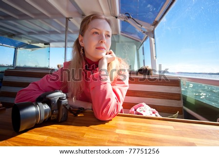 Young woman tourist aside on sea. - stock photo