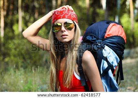 Young woman tourist making her journey. - stock photo