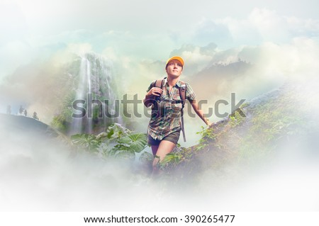 Young woman tourist with a backpack walking in the rain forest on background mountains. Concept eco tourism, hiking in the mountains. Concept eco tourism, hiking in the mountains. - stock photo