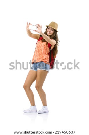 Young woman tourist with camera and backpack, isolated on white - stock photo