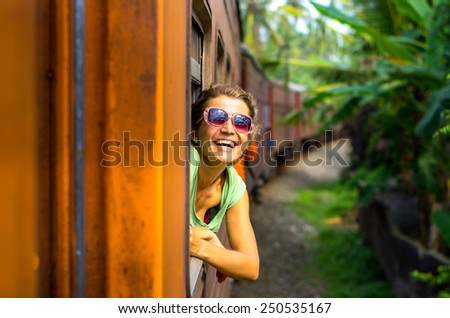 Young woman traveling by train in Sri Lanka - stock photo