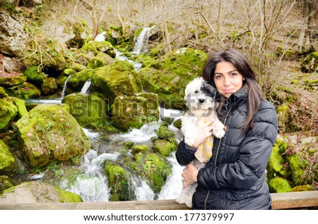 young woman traveling in the autumn mountain with her dog - stock photo