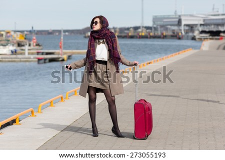 Young woman traveling with suitcase. - stock photo