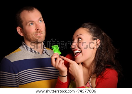 young woman trying to convince her partner that condoms are better - stock photo