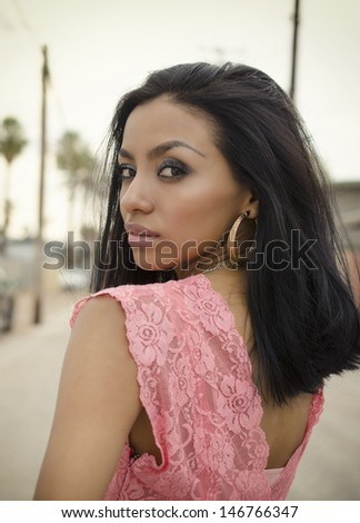 Young woman turning head face around looking back. - stock photo