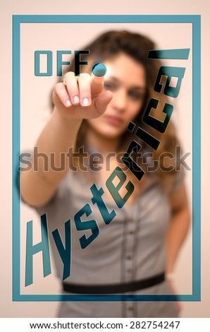 young woman turning off Hysterical on screen - stock photo