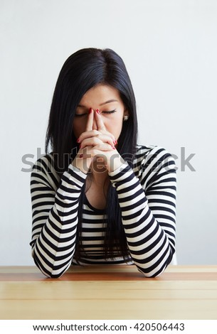 Young woman under stress with headache and migraine - stock photo