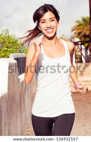 Young woman urban exercising - stock photo