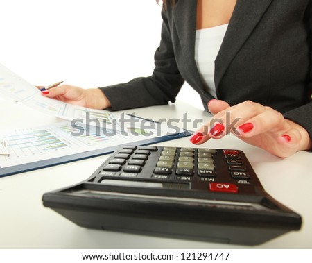 Young woman using a calculator - stock photo
