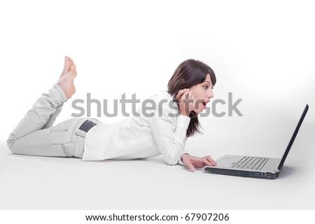 Young woman using a laptop computer on the floor - stock photo