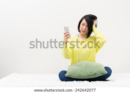 Young woman using a smart phone. - stock photo