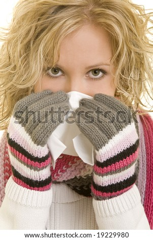 Young woman using a tissue - stock photo