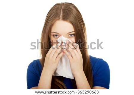 Young woman using a tissue. - stock photo