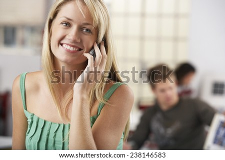 Young Woman Using Cell Phone - stock photo