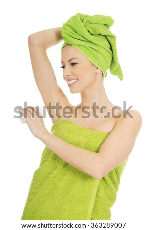 Young woman using deodorant. - stock photo