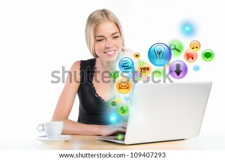 Young woman using her laptop for multimedia and site surfing. Different icons appearing from the screen - stock photo
