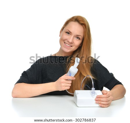 Young woman using nebulizer for respiratory inhaler Asthma Treatment isolated on a white background - stock photo