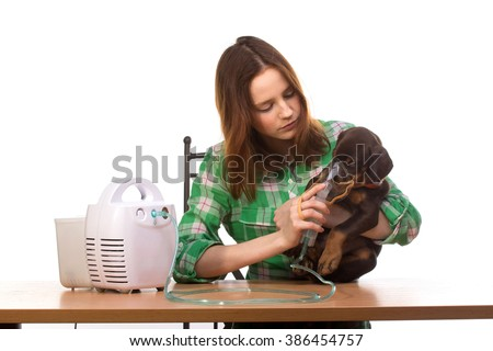 Young woman using nebulizer mask for respiratory inhaler dog Treatment isolated on a white background - stock photo