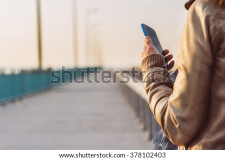 Young woman using smart-phone - stock photo