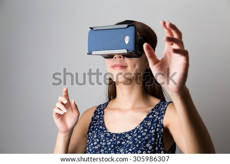 Young Woman using with virtual reality device - stock photo