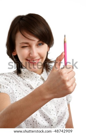 young woman virtually measuring with a pencil - sharpness on pencil - stock photo