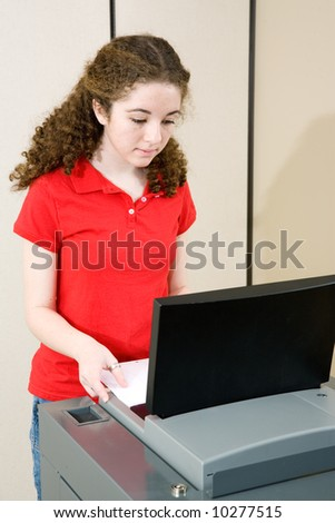 Young woman voting on new optical scan machine used in Florida. - stock photo