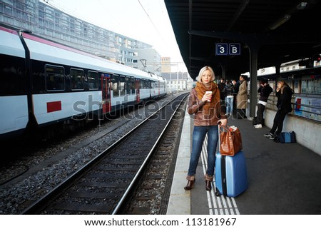 Young woman waiting a train on the station - stock photo