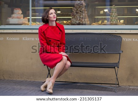 Young woman waiting her friend looking at sky - stock photo