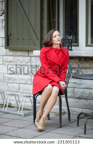 Young woman waiting her friends at street cafe  - stock photo