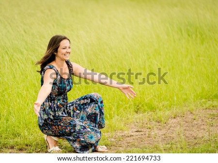 Young woman waiting with hands stretched somebody coming to her - stock photo