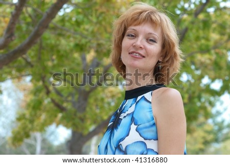 Young woman walking in autumn park, soft background - stock photo