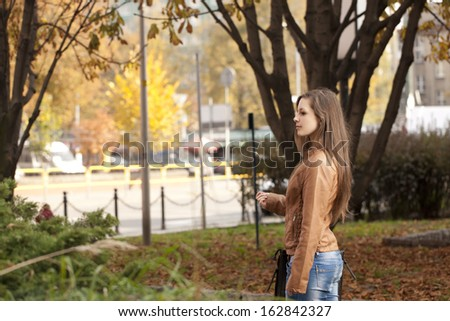 Young woman walking in park - stock photo