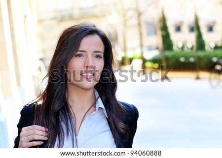 Young woman walking in town - stock photo