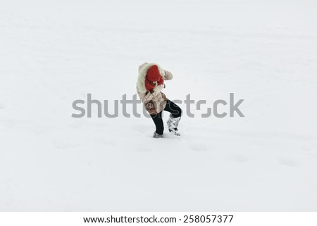 young woman walking on the deep snow - stock photo